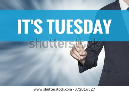 Its Tuesday word on virtual screen touch by business woman cyan sky tab - stock photo