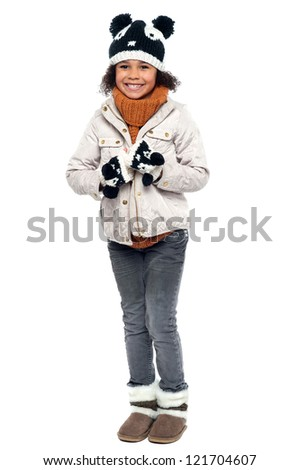 Its winter time. Little fashionable girl in warm clothes. - stock photo