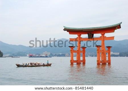 Itsukushima Shrine on the island of Miyajima. The famous floating torii at Itsukushima Shrine. - stock photo