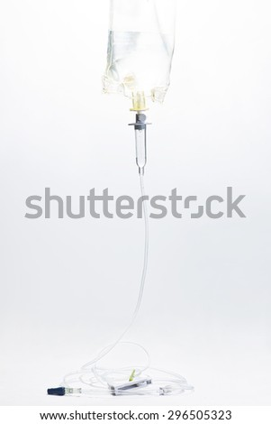 IV drip chamber, IV tubing,  and IV bag of solution. - stock photo