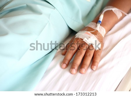 IV solution in a patients hand - stock photo