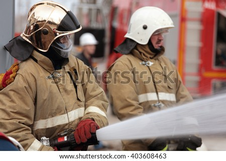 IVANGOROD, LENINGRAD OBLAST, RUSSIA - MARCH 29, 2016: Fire fighting during the emergency training at Narvskaya Hydroelectric Power Plant. Built in 1956, it has nameplate capacity 125 MW - stock photo