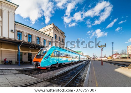 Ivano-Frankivsk, Ukraine - February 2016: Train at the railway station in Ivano-Frankivsk. One of oldest train station in Ukraine. Train at the station. - stock photo