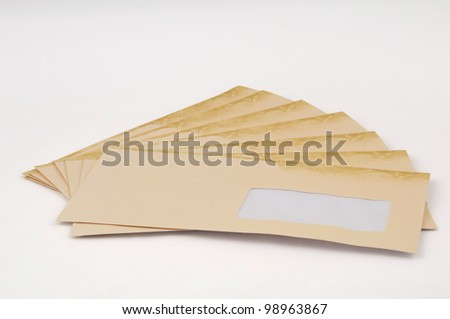Ivory envelopes isolated on a white background. - stock photo