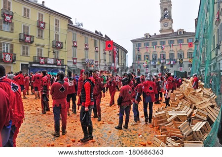 IVREA - MARCH 3: Carnival of Ivrea. The battle of oranges. Unidentified players of Picche team before the throwing. On March 3, 2014 Ivrea, Italy. - stock photo