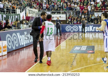 IZMIR - FEBRUARY 15: Pinar Karsiyaka's coach UFUK SARICA has tactics to his player in Turkish Basketball League game between Pinar Karsiyaka 92-84 Anadolu Efes on February 15, 2015 in Izmir - stock photo