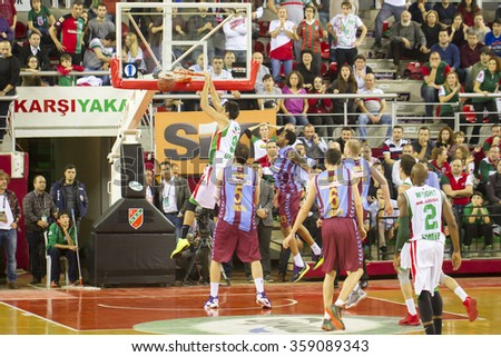 IZMIR JANUARY 06: Pinar Karsiyaka's EGEMEN GUVEN slam dunks to the basket in Eurocup game between Pinar Karsiyaka 81-68 Trabzonspor Medical Park on January 06, 2016 in Izmir - stock photo