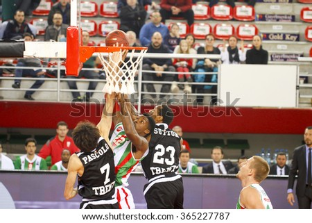 IZMIR JANUARY 20: Pinar Karsiyaka's KENNY KENNETH BENARD GABRIEL slam dunks to the basket in Eurocup game between Pinar Karsiyaka 79-85 Dolomiti Energia Trento on January 20, 2016 in Izmir - stock photo