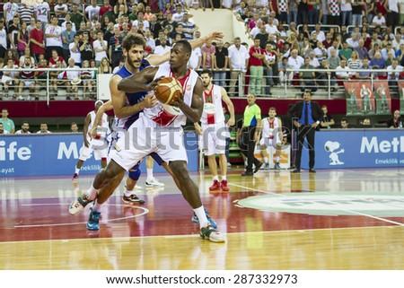 IZMIR - JUNE 14: Pinar Karsiyaka's JUAN DIEGO TELLO PALACIOS posts up in Turkish Basketball League game between Pinar Karsiyaka 71-65 Anadolu Efes on June 14, 2015 in Izmir - stock photo