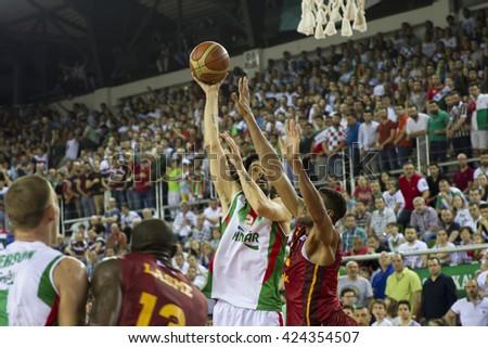 IZMIR - MAY 20: Pinar Karsiyaka's KEREM GONLUM hook shoot in Turkish Basketball League game between Pinar Karsiyaka 62-65 Galatasaray Odeabank on May 20, 2016 in Izmir - stock photo