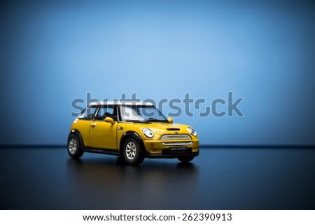 Izmir, Turkey - February 28, 2015.  Mini Cooper S Toy car on blue background. - stock photo