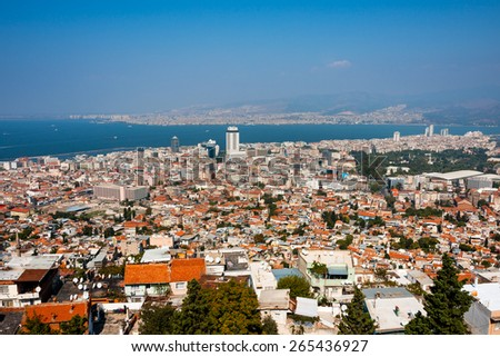 IZMIR, TURKEY - OCTOBER 04, 2014:  Birds eye panorama of high density housing of the Izmir center. View of the Aegean Sea and Mount Yamanlar in the background - stock photo