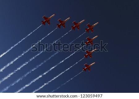 "IZMIR, TURKEY - SEPTEMBER 09: Turkish Air Force Aerobatic Demonstration Team ""Turkish Stars"" performs during Izmir Independence Day on September 09, 2012 in Izmir, Turkey - stock photo"