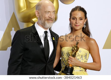 J.K. Simmons and Alicia Vikander at the 88th Annual Academy Awards - Press Room held at the Loews Hollywood Hotel in Hollywood, USA on February 28, 2016. - stock photo