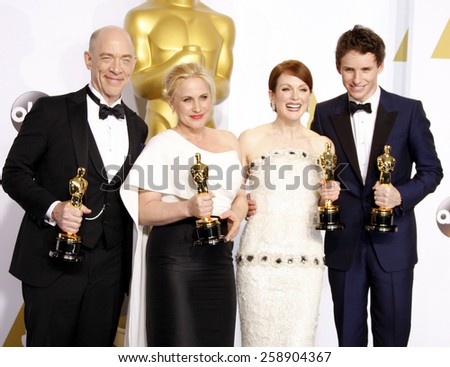 J.K. Simmons, Patricia Arquette, Eddie Redmayne and Julianne Moore pose in the press room during the 87th Annual Academy Awards at Loews Hollywood Hotel on February 22, 2015 in Hollywood, California. - stock photo