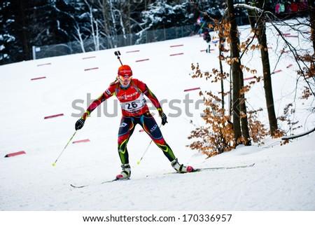 JABLONEC NAD NISOU, CZECH REPUBLIC - MARCH 22: Czech biathlete Gabriela Soukalova climbs the hill during Czech Biathlon Championships 2013, March 22, 2013 in Jablonec nad Nisou, Czech republic - stock photo