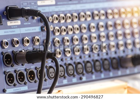 Jack audio connectors is connected to sound mixer. - stock photo