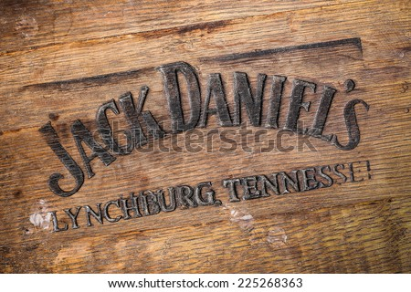 Jack Daniels whiskey logo burned at the bottom of old wooden barrel - stock photo