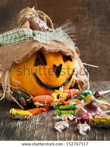 Jack-o-lantern and Halloween candy   - stock photo