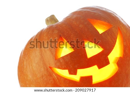Jack O Lantern halloween pumpkin with candle light inside isolated on white background - stock photo