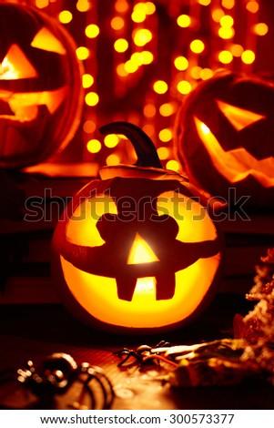 Jack-o-lanterns burning in darkness - stock photo