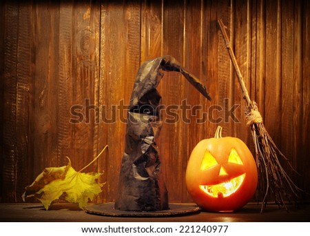 Jack o lanterns  Halloween pumpkin face on wooden background and spooky - stock photo