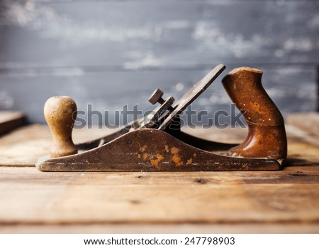 Jack-plane on wooden table, small dof - stock photo