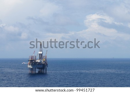 Jack up drilling rig in the middle of the coean - stock photo