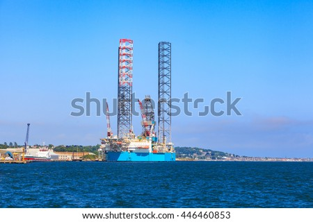 Jack up oil drilling rig in the shipyard for maintenance in Dundee, Scotland, UK - stock photo