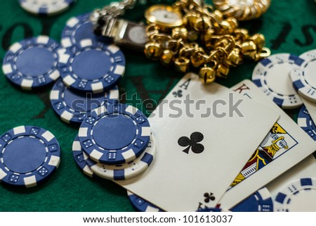 Jackpot winnings on table with high face cards and blue poker chips, - stock photo