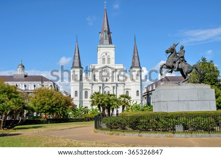 Jackson Square - View of two attractions of Jackson Square, Saint Louis Cathedral and the equestrian statue of Andrew Jackson, in the French Quarter of New Orleans, Louisiana, USA. - stock photo