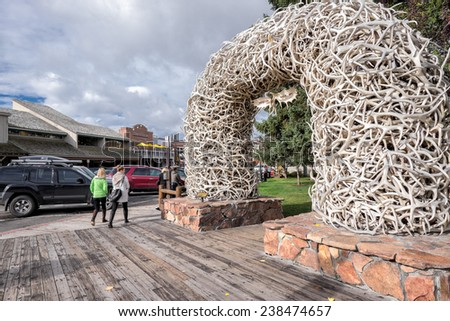 JACKSON, WY, USA  OCTOBER 1: Elk antler arch at the Town Square on October 1, 2014 in Jackson, WY. Jackson is a gateway for downhill skiing and for tourists visiting Grand Teton and Yellowstone. - stock photo