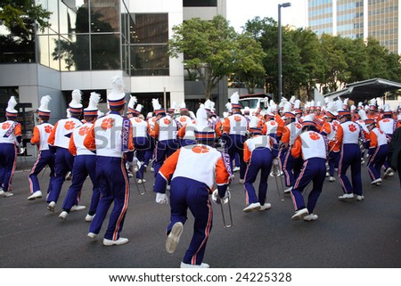 JACKSONVILLE, DECEMBER 30, 2008: Clemson Marching Band, marching in the Gator Bowl Parade in Jacksonville, Florida. The parade leading up to the January 1, 2009 Gator Bowl football game between Clemson and Nebraska. - stock photo