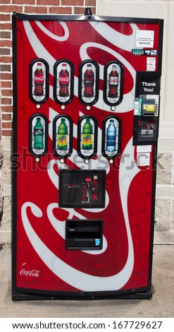 JACKSONVILLE, FL - DEC 6: A Coke machine in Jacksonville, Florida on December 6, 2013. Coca-Cola Co. is splitting its American business into 2 operating units: Coke N. America and Coke Refreshments.  - stock photo