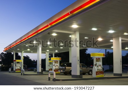 JACKSONVILLE, FL-MAY 16, 2014: A Shell gas station in early morning in Jacksonville. According to Forbes, Royal Dutch Shell oil company is the 5th largest company worldwide. - stock photo