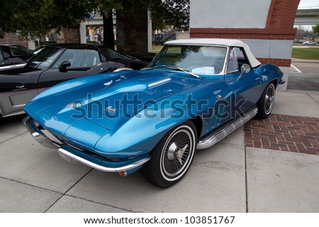 JACKSONVILLE, FLORIDA - FEBRUARY 18: A 1966 Blue Chevy Corvette 427 Turbo-Jet on display at the Jacksonville Car Show on February 18, 2012 in Jacksonville, Florida. - stock photo