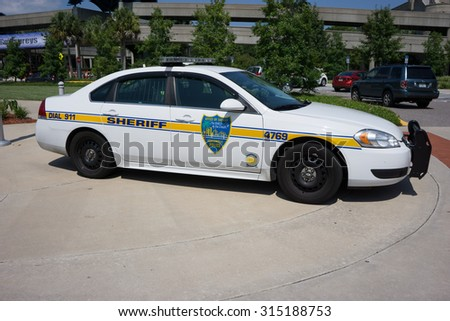 JACKSONVILLE, FLORIDA - JULY 30, 2015: A Jacksonville Sheriff's Office (JSO) police car parked in Jacksonville. JSO currently employs about 1,600 police officers and about 700 correctional officers. - stock photo