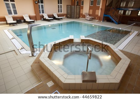 jacuzzi bath near the swimming pool - stock photo