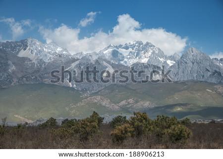 Jade Dragon Snow Mountain in cloud - stock photo