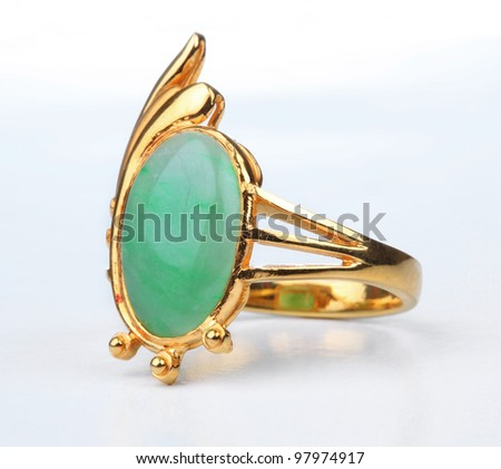 Jade gold ring isolated on white background. - stock photo