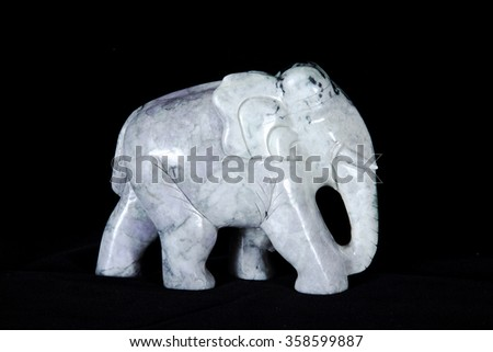 Jade sculpture of elephant isolated on black background. - stock photo