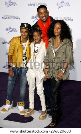 Jaden Smith, Willow Smith, Will Smith and Jada Pinkett Smith at the Los Angeles premiere of 'Justin Bieber: Never Say Never' held at the Nokia Theatre L.A. Live in Los Angeles on February 8, 2011.  - stock photo