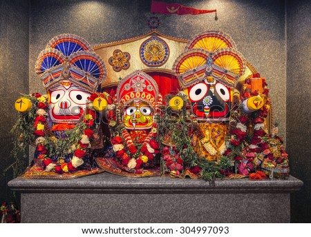 Jagannath idol with his elder brother Balabhadra and sister Subhadra, in Hindu Temple. Jagannath, believed to be an avatar of Lord Vishnu. - stock photo