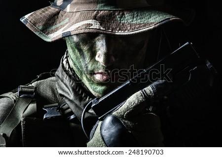 Jagdkommando soldier Austrian special forces with pistol on dark background  - stock photo