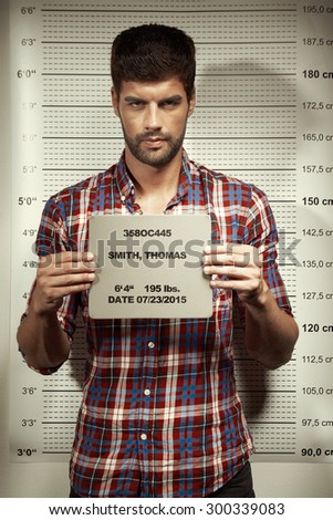 Jailed criminal - mugshot - stock photo