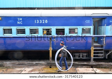 Jaipur, India - January 3, 2015: passengers at the window of a Indian Railway train at the railway station of Jaipur, Rajasthan, India. Indian Railways carries about 7,500 million passengers annually. - stock photo