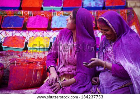 JAIPUR, INDIA - MARCH 17: Lady in violet, on Holi festival, March 17, 2013, Jaipur, India. Holi, the festival of colors, marks the arrival of spring, one of the biggest festivals in India - stock photo