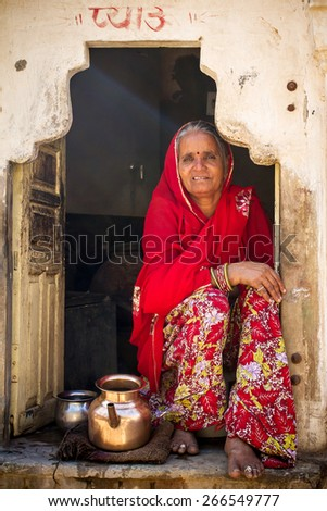 JAIPUR, INDIA - NOVEMBER 27, 2012: Portrait of unidentified Indian woman in Jaipur, India - stock photo