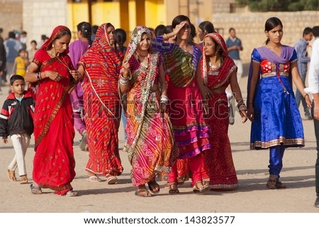 JAISALMER, INDIA - FEB 24:  group of women at the Desert Festival on Feb 24, 2013 in Jaisalmer, India.  The festival is held annually in winter to attract both domestic and international tourists. - stock photo