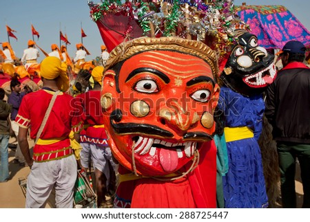JAISALMER, INDIA - Feb 1: Horror demons faces of Hinduism on carnival crowd of the popular Desert Festival on February 1, 2015 in Rajasthan. Every winter Jaisalmer takes famous Desert Festival - stock photo
